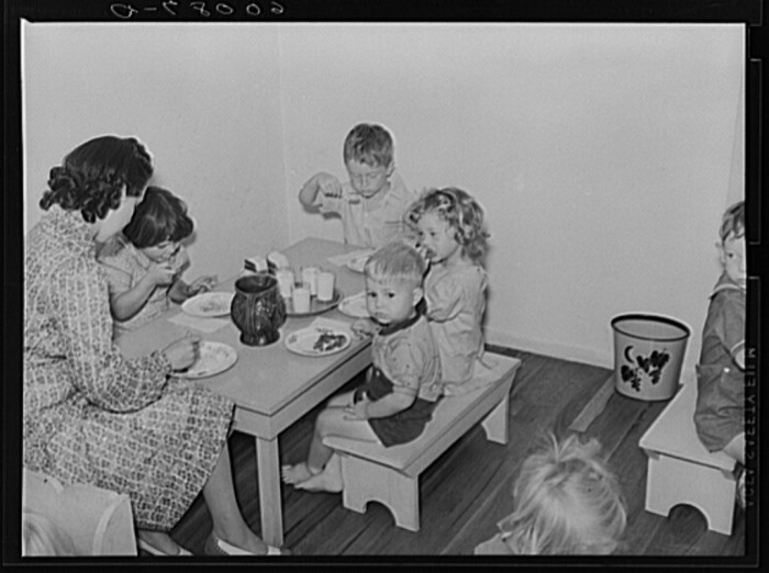10. These school children at a nursery school in the Tygart Valley Homesteads are having lunch in this 1939 photo.