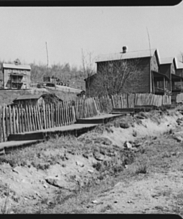 3. Here, open ditches carry sewage down the street in Kempton, 1939.