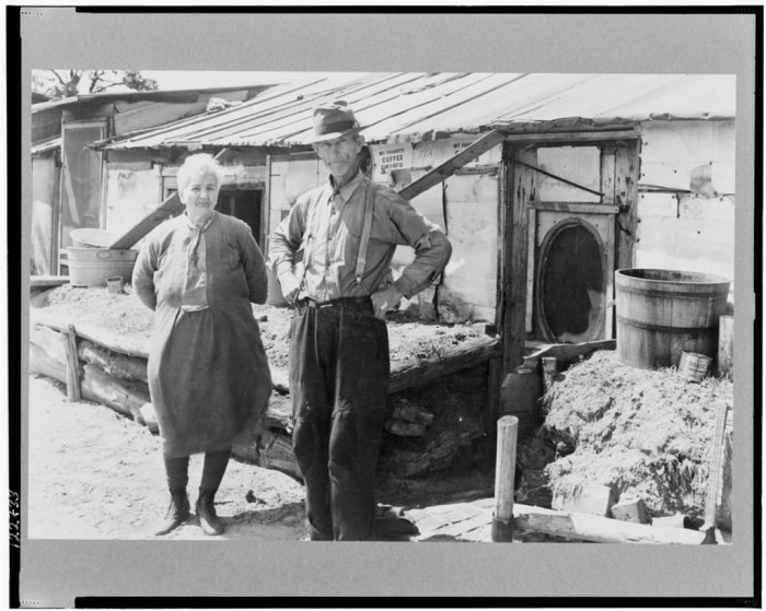1. This man and wife are standing in front of their log and peat cabin in Juneau in 1936.