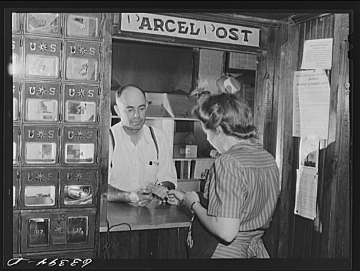 3. This woman is buying stamps from the post office in Siren in 1941.