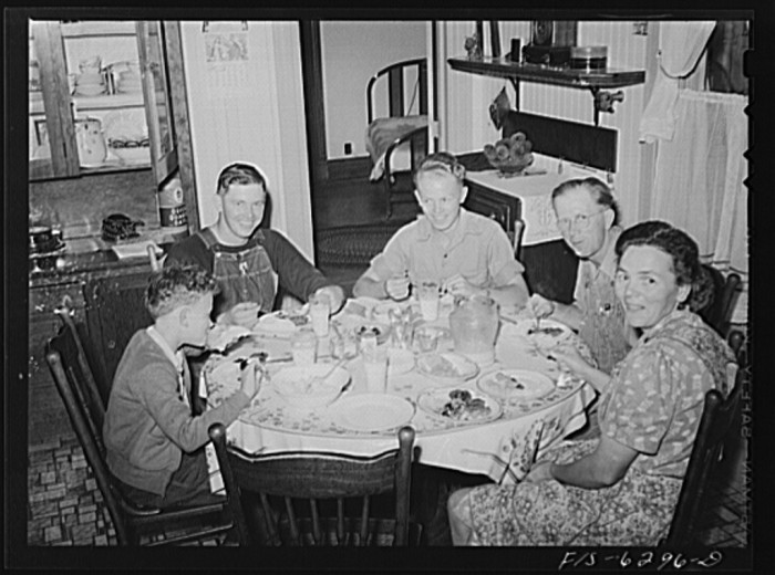 12. This family is sitting around the table in 1942 in Vernon County.