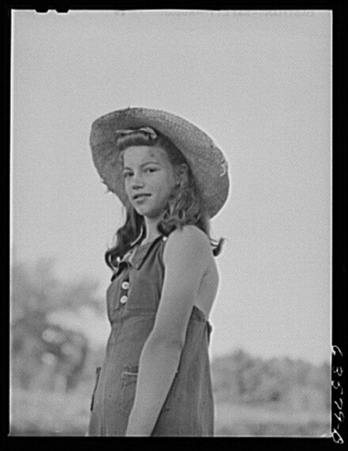 14. This lady is taking a break from bean picking in Shawano in 1941.