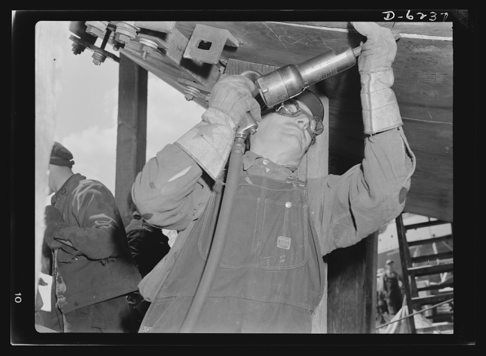 16. These men are working on submarines in Manitowoc in 1942.