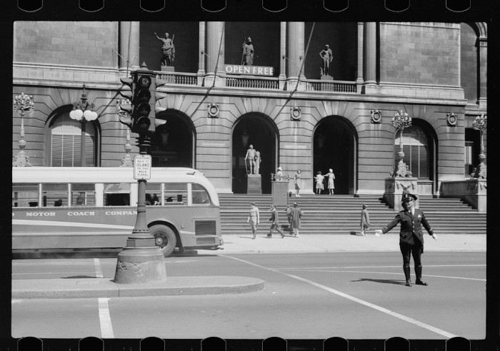 2. A man directs traffic in front of the Art Institute of Chicago in 1940.