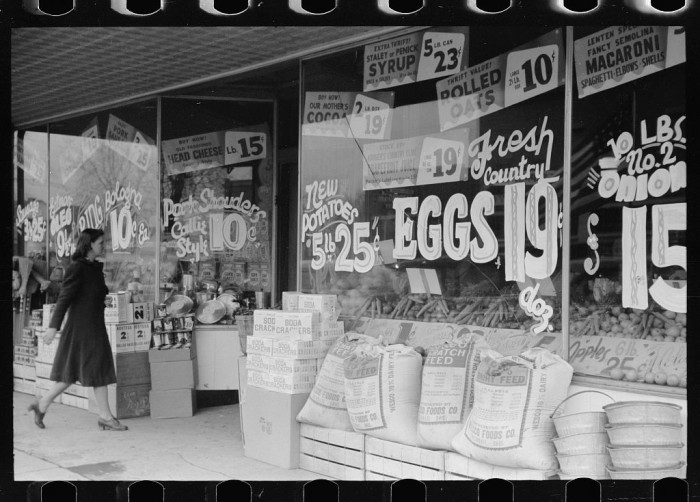 7. A woman walks into a grocery store in Marion in 1940.