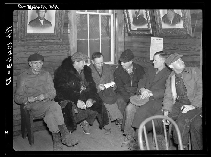 8. Farmers hang out at a soil conservation meeting in Livingston County in 1937.