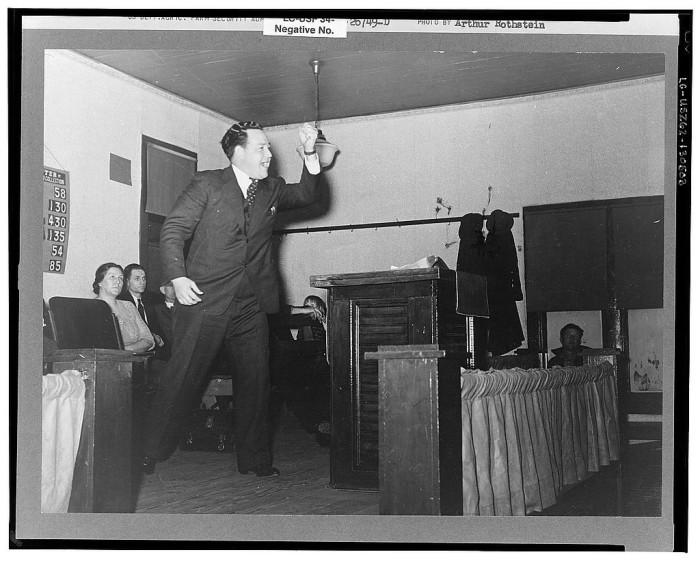 15. An evangelist preaches a sermon in Cambria in 1939.