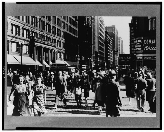 18. People walk down State Street in Chicago in 1940.