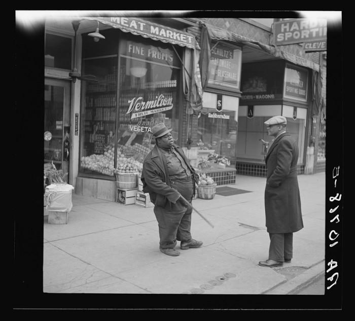 19. Men talk on the street in Danville in 1937.