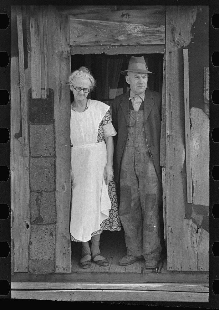 5. A man and woman stand at the back of their farmhouse in Marseilles in 1937.