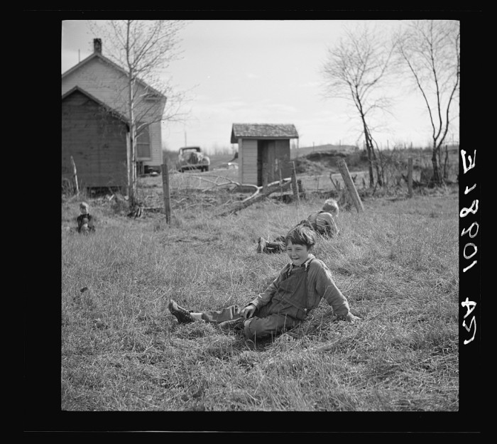 3. These children take a rest during recess at a rural school near Tipler, Wisconsin.