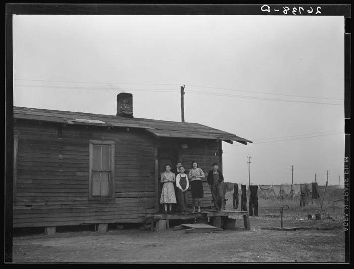 4. Miner's children stand on porch of their Zeigler home in 1939.