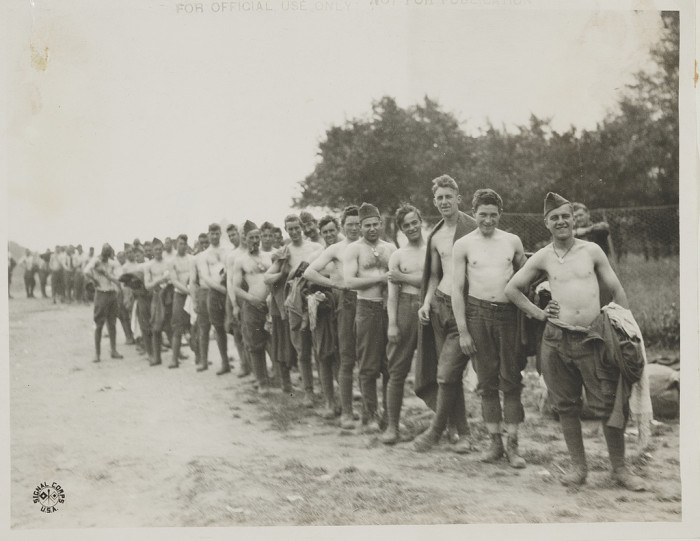 1. Massachusetts infantry soldiers up to turn in their clothing for replacement and disinfection, 1918.