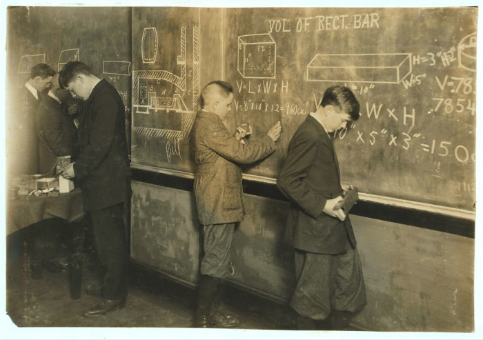 7. Young boys studying math at a printing vocational school in Fall River, 1916.