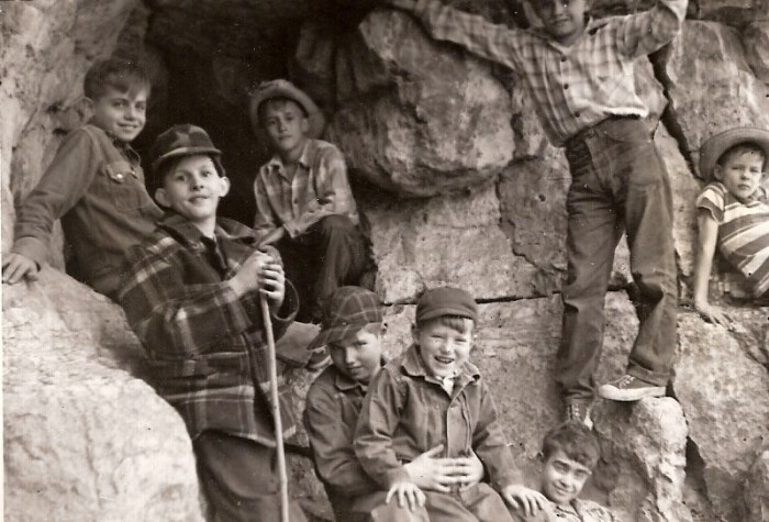 1.	Boys exploring the Jesse James Cave, high on the bluffs overlooking the Missouri River near Sugar Creek, 1950.