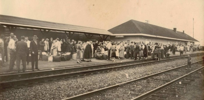 11. A crowd gathers at the train station in Picayune.