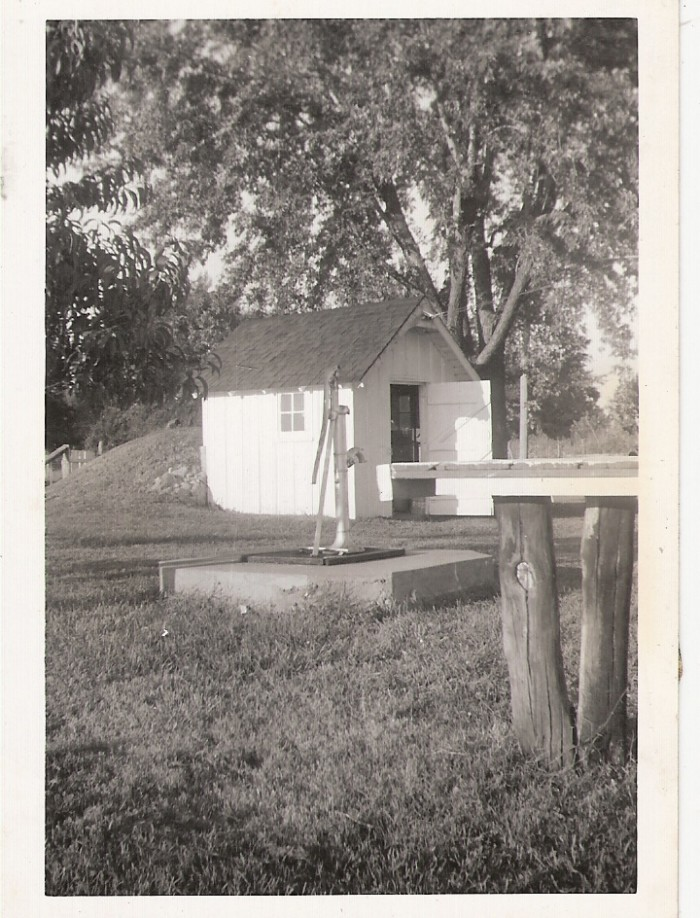 11.	Well house and pump in Dunlap, 1957.