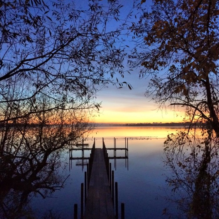 5. This breathtaking view of the morning sun rising over one of the perfectly beautiful Iowa Great Lakes.