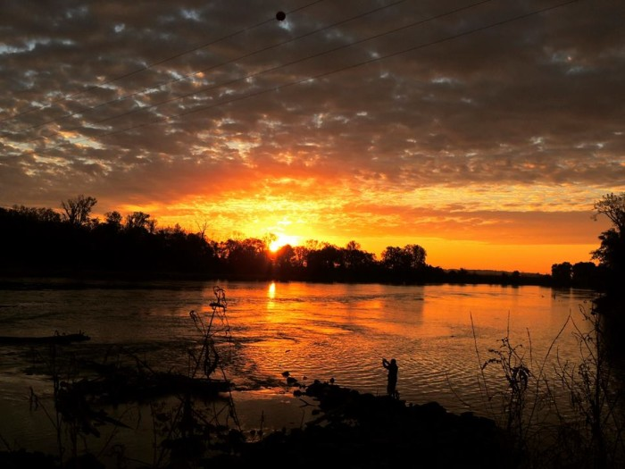 7. This bright orange sunset burns up the sky over Red Rock Dam in Marion County.