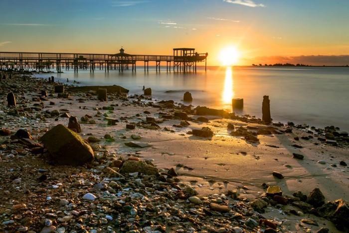 6. Rocky shores, peaceful sun.