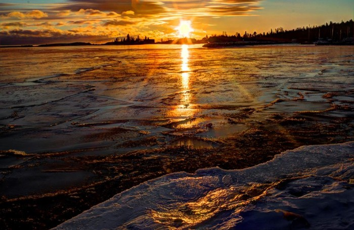 15. The sunset in Grand Marais Harbor is the perfect ending to any day.