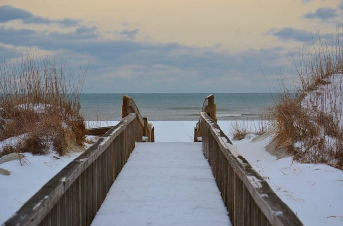 6. A snowy walkway to the shore.