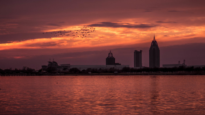 2. A gorgeous sunset view of the Mobile, Alabama skyline.