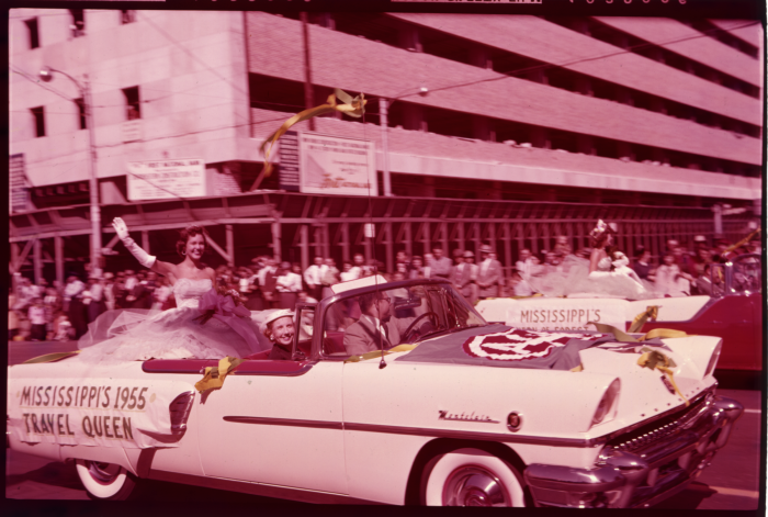 8. Four years prior to winning Miss America, Mary Ann Mobley happily waves at the crowd from a white convertible.