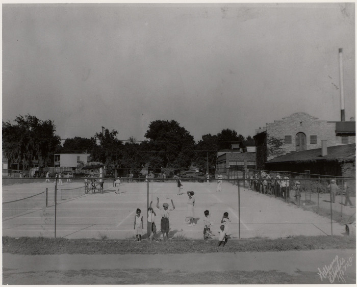 14.  Playing tennis, Kansas City.