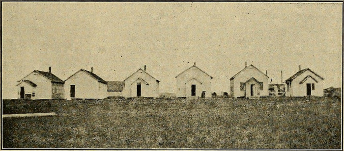 10. While waiting for the new, consolidated school to be built in Rolf, the one-room schoolhouses were moved from their locations and lined up next to each other.