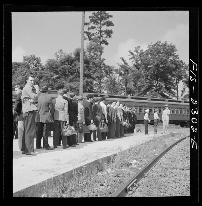 15. New recruits arrive at the train station on their way to Parris Island, SC in 1942.