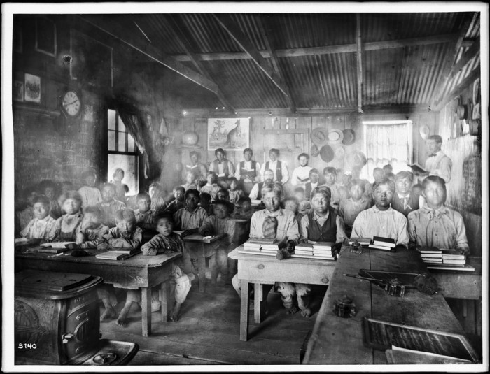 5.These Walapai students sit in their school at Hackbury in 1900.