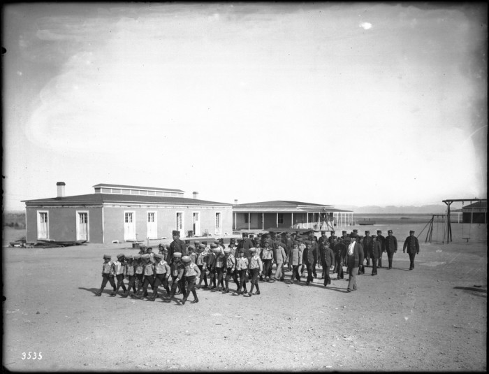 4. This one shows the boys in the previous photo marching in formation in front of their school.