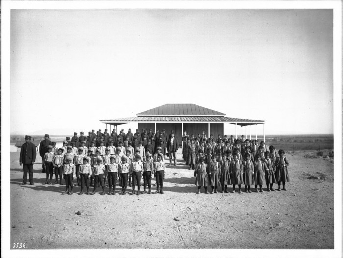 3. Here is the 1900 class of an Indian school in Yuma standing in front of their schoolhouse.