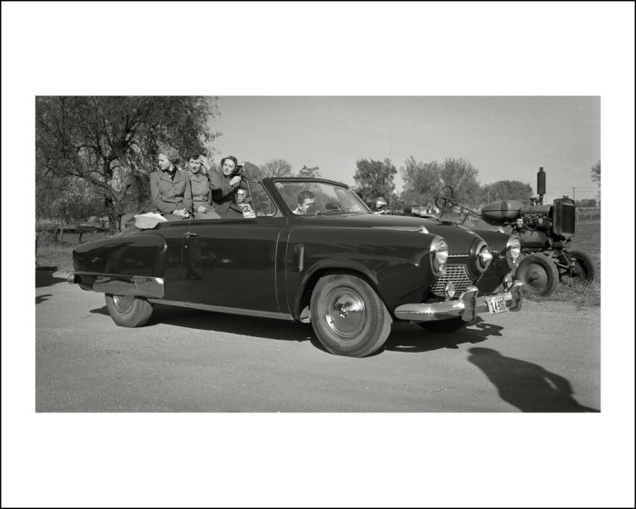 11. This group of young people cruises around Glidden in a Studebaker during 1951.