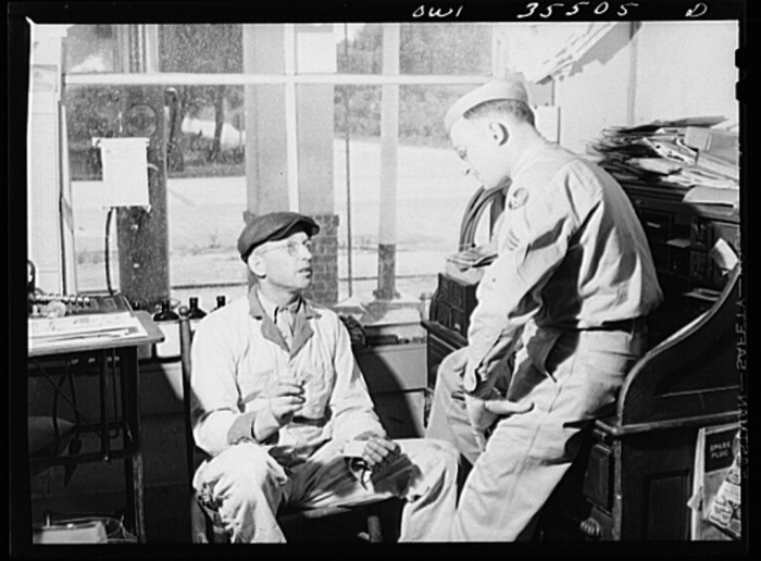 17. A Sergeant with the 25th service group, Air Service Command, is home on leave in Bowman, SC in 1943. Here, he's listening to his father, Mr. Riley, explain gas rationing.