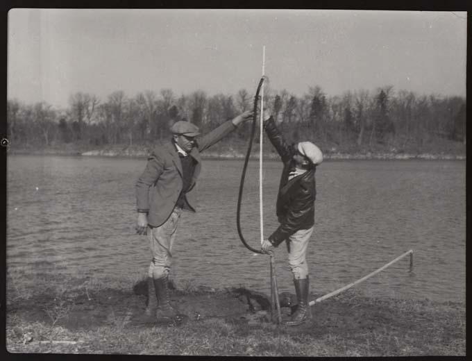 18.  Two men in front of Lake Ha Ha Tonka.