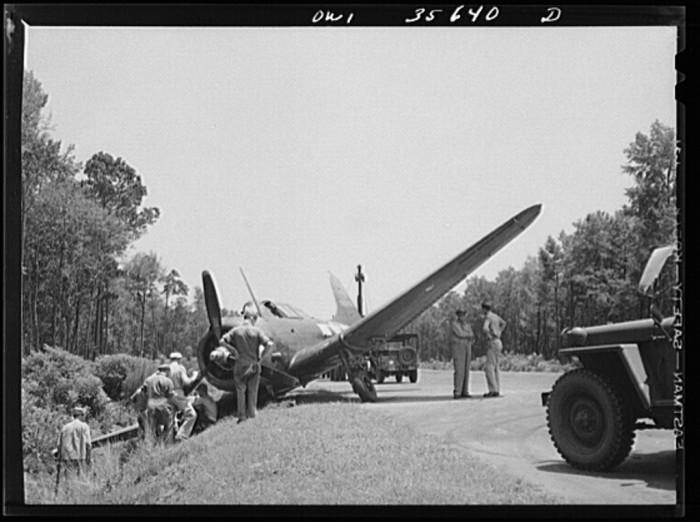 19. Myrtle Beach SC Air Service Command - a team works on an A-20 that ran off the air strip.