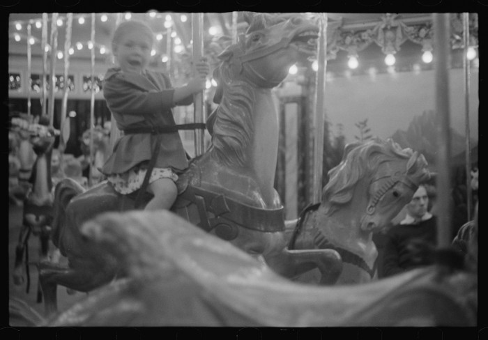 13) A little girl enjoys the merry-go-round at Glen Echo Park.