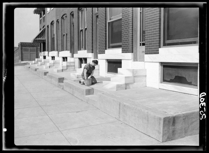 1) This woman scrubs the steps of these Baltimore Row Houses to keep them sparkling white.