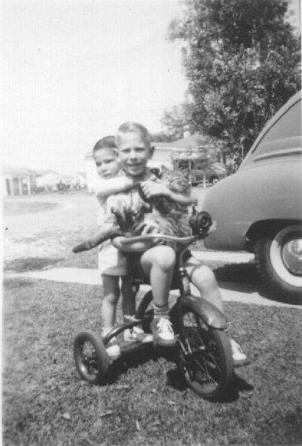 18. Two boys and a trike