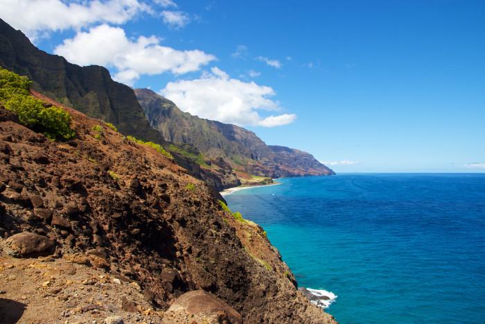 2) Explore Kauai's Na Pali State Wilderness Park.