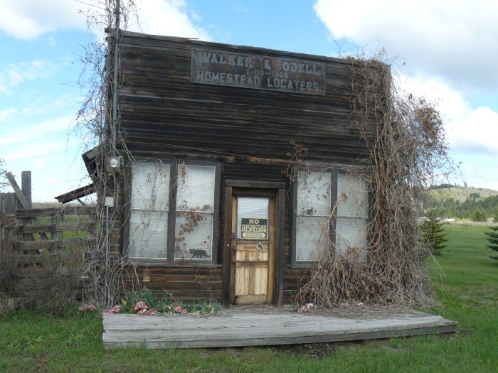 "9. The remains of an old ""Homestead Locaters"" office in Molson."