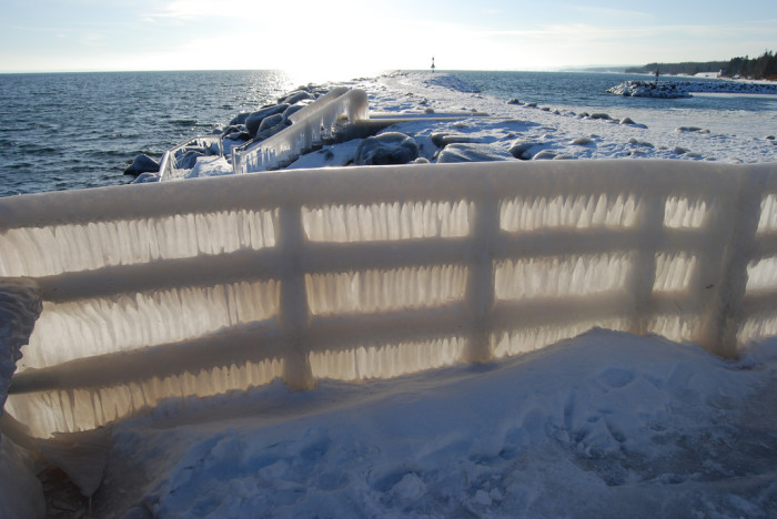 2. On Lake Superior, this harbor staircase is completed covered in ice creating a frozen window for light to filter through.
