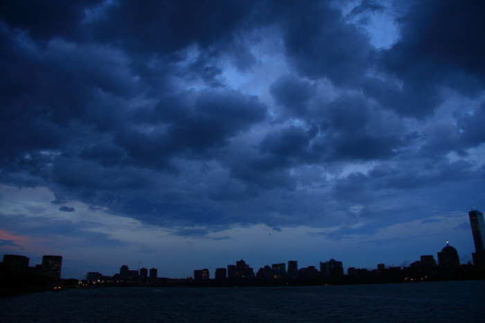 2. A rolling blanket of purple and black clouds hovers over Kendall Square in Cambridge.