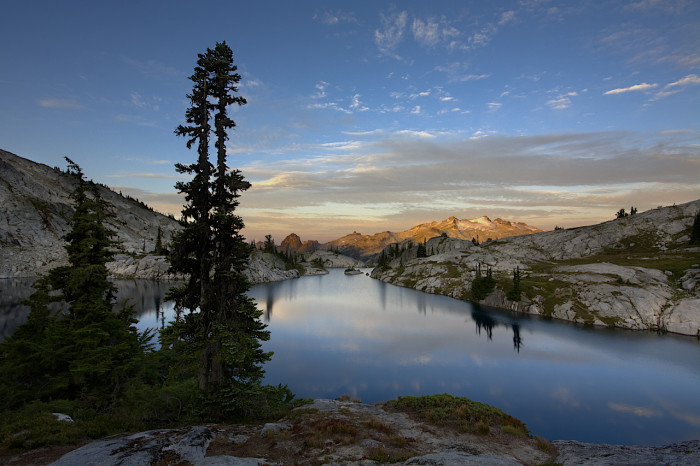 4. In this shot, you can see the sun rising over the beautiful Robin Lakes in the Alpine Lakes Wilderness.