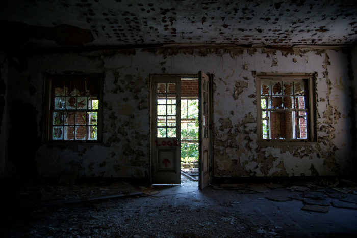 Peeling paint and a vague graffiti message are just the beginning of this eerie tour.