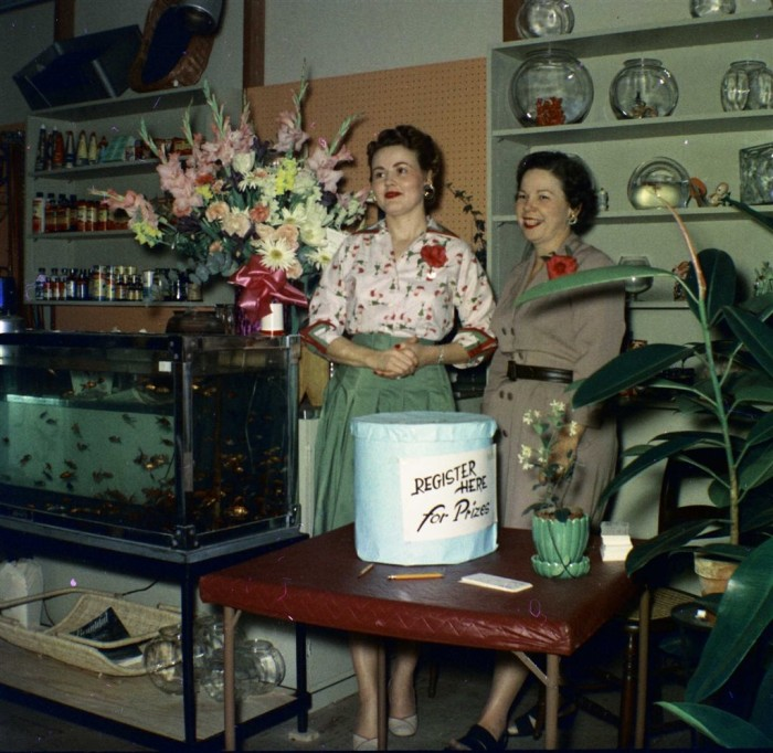 4. An area pet store celebrates its grand opening in 1955.