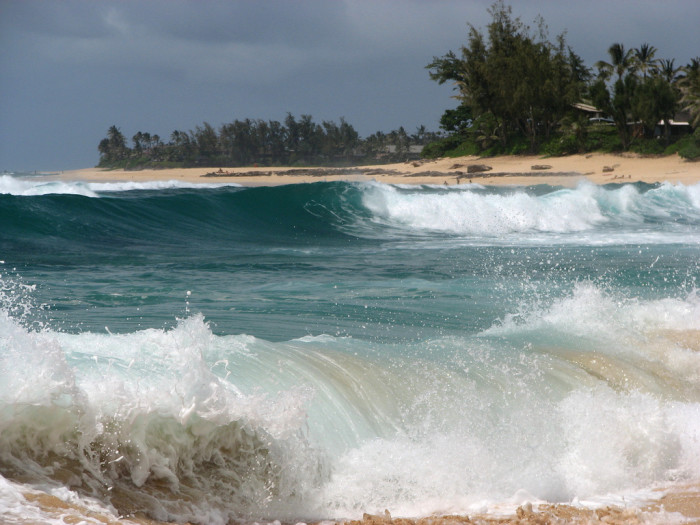 4) Watch the waves crash against the shore during the winter.