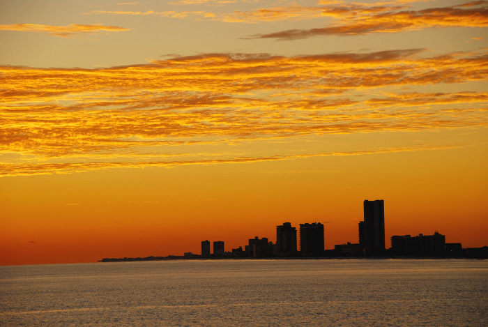 5. A coastal sunset creates a lovely skyline view of Gulf Shores, Alabama.